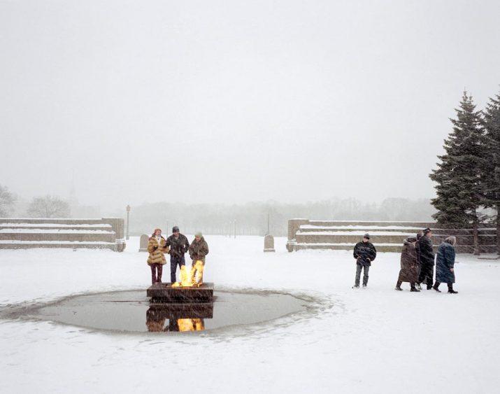 Friends keep warm by the eternal flame, St Petersburg, Northwestern Region, December 2004