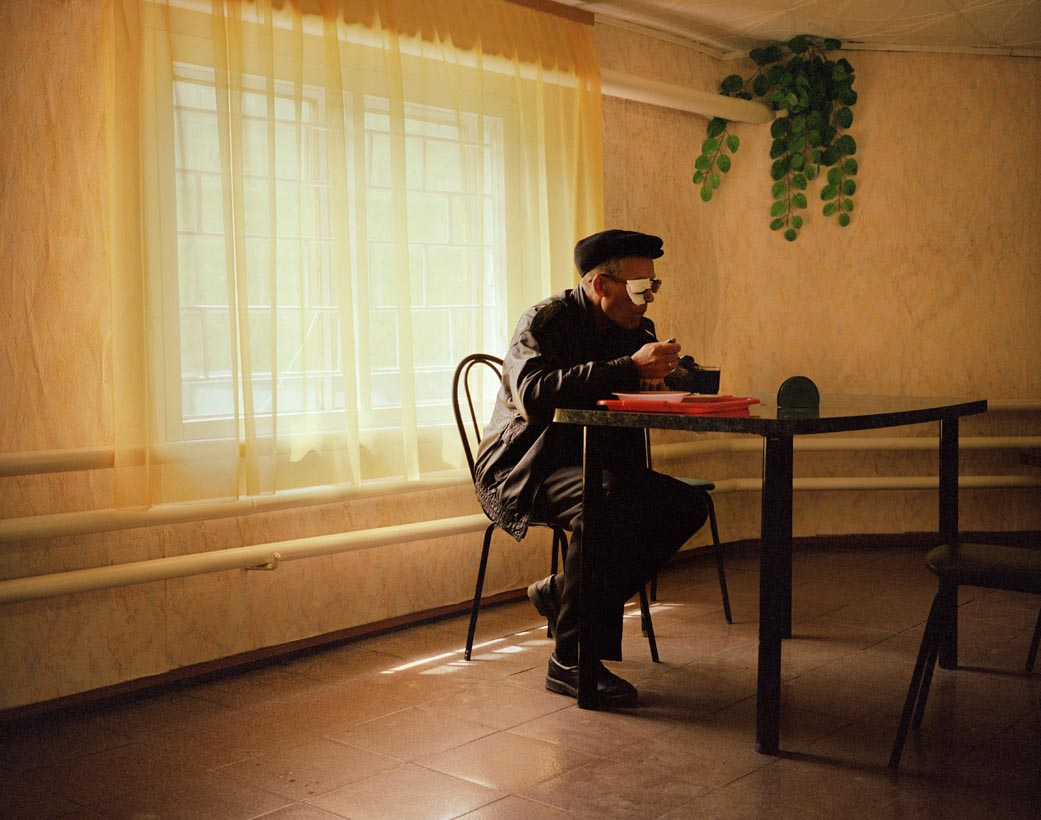 A man eats lunch in a roadside cafe, Altai Mountains, Western Siberia, June 2005