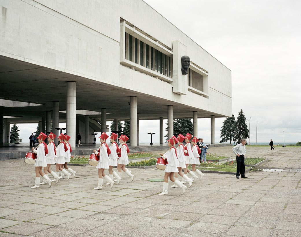 A marching school band pass under Lenin, Ulyanovsk, Volga, June 2005