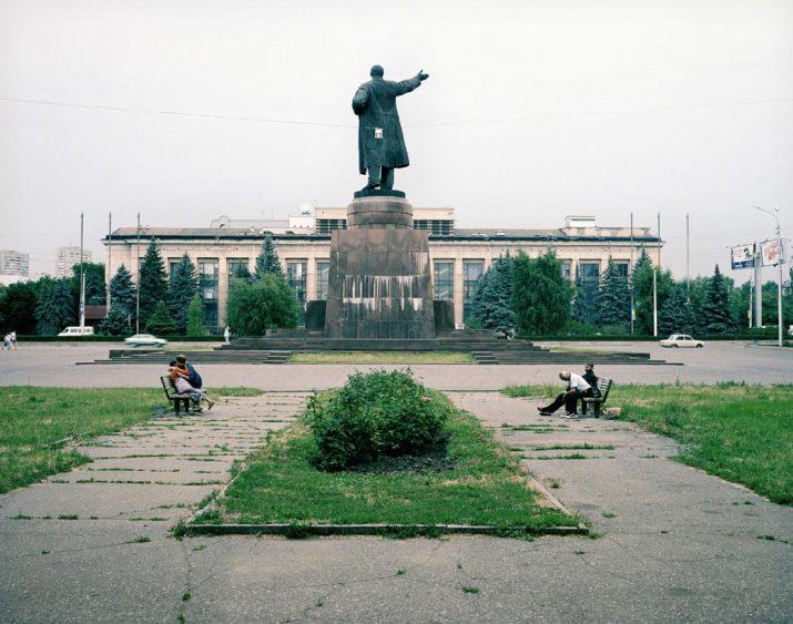 Two friends embrace behind Lenin, Volgograd, Volga, June 2005