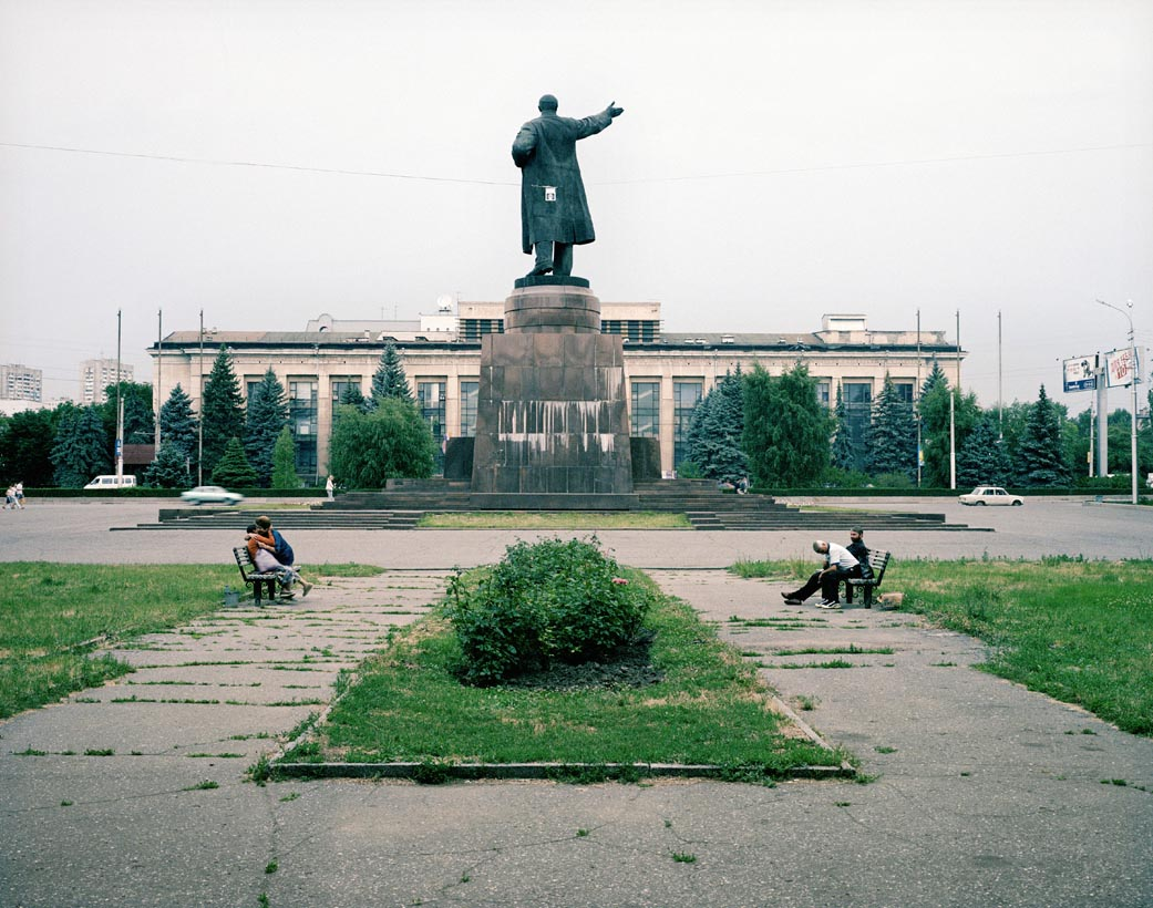 Two friends embrace behind Lenin, Volgograd, Volga, June 2005