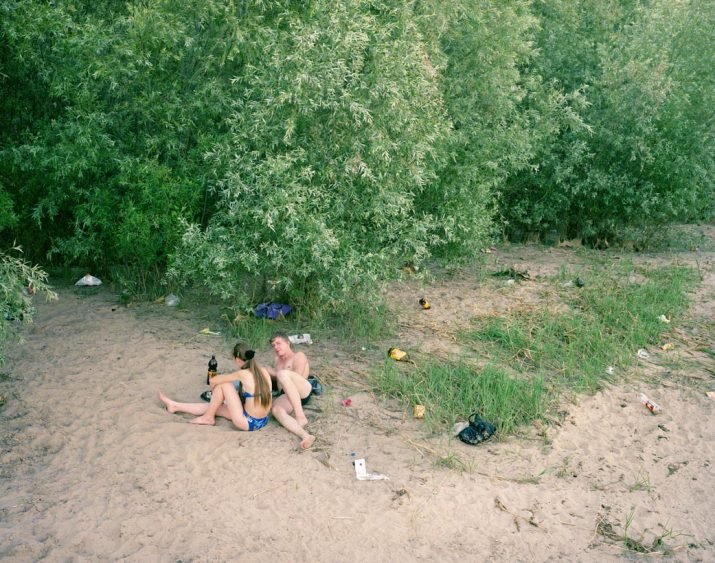 Young lovers on the banks of the Volga River, Astrakhan, Volga, June 2005